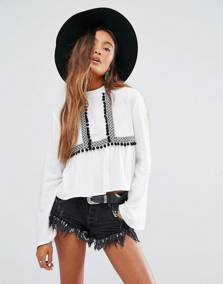 Young Bohemians High Neck Top With Wide Sleeves And Pom Pom Trim - White