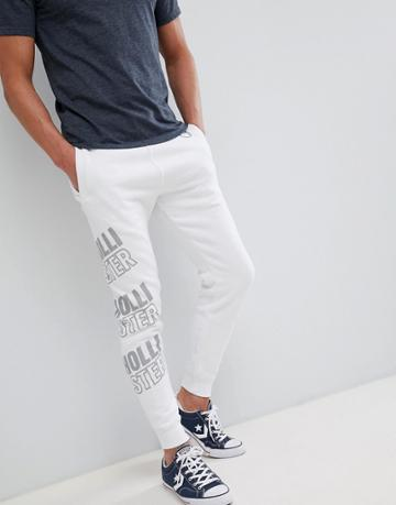 Hollister All Over Print Logo Super Skinny Joggers In White - White