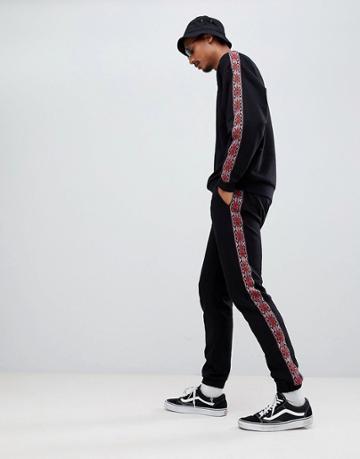 Asos Design Skinny Joggers With Geo-tribal Side Stripe - Black