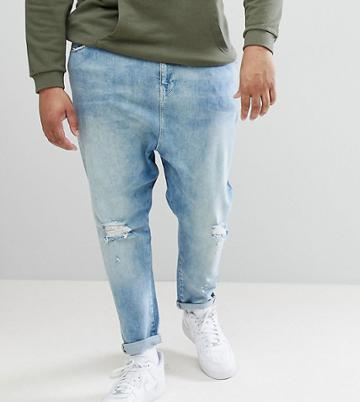 Asos Design Plus Drop Crotch Jeans In Mid Wash Blue With Rips - Blue
