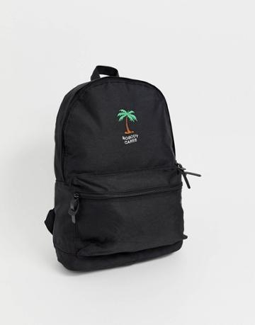 Asos Design Backpack In Black With Nobody Cares Print And Palm Tree - Black