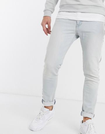 Levi's 512 Reflective Side Tape Slim Tapered Low Rise Jeans In Bleach Light Wash-blue