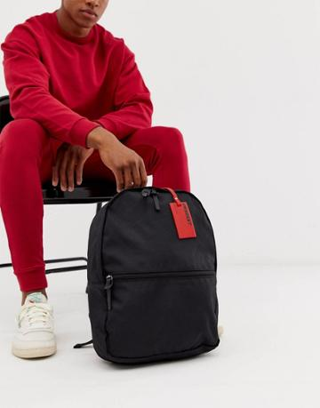 Asos Design Backpack In Black With Red Luggage Tag - Black