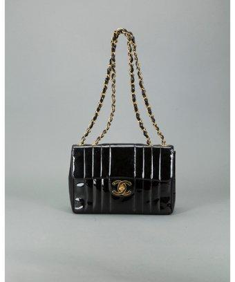 Chanel Pre-owned: Black Patent Leather Vertical Quilt 'maxi Flap' Bag