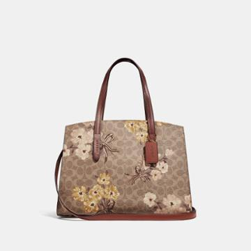 Coach Charlie Carryall In Signature Canvas With Prairie Floral Print