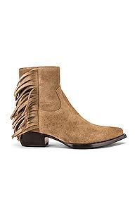 Saint Laurent Lukas Fringe Boots In Neutral