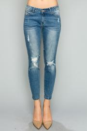 Mid Rise Distressed Skinnies