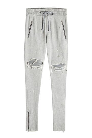 Amiri Amiri Distressed Cotton Sweatpants With Leather Patches