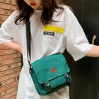 Embroidery Buckled Messenger Bag