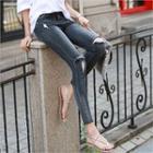 Slit-knee Distressed Skinny Jeans