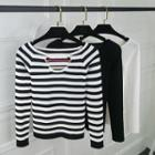 Plain / Striped Long-sleeve Cut-out Knit Top