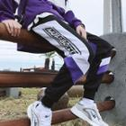 Cropped Color Panel Lettering Jogger Pants