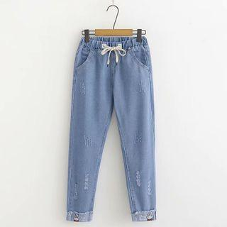 Cartoon Embroidered Distressed Tapered Jeans