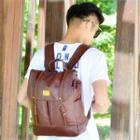 Faux Leather Double Buckled Backpack