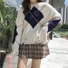 Argyle Ripped Boxy Sweater / Pleated Skirt