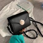 Disc Accent Flap Crossbody Bag
