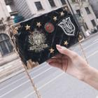 Batch Embroidered Quilted Crossbody Bag