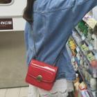 Disc Accent Crossbody Bag