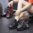 Patent Platform Wedge Sneakers