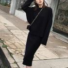 Set: Long-sleeve Plain Knit Sweater + A-line Midi Skirt