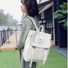 Canvas Buckled Flap Backpack