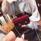 Twist Lock Patent Crossbody Bag