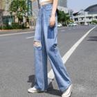 High-waist Patched Distressed Wide-leg Jeans