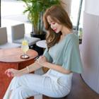 Padded-shoulder Flare-sleeve Top