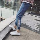 Applique Straight-cut Washed Jeans