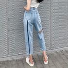 High-waist Ripped Jeans