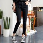 Slit-knee Distressed Skinny Pants