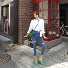 Asymmetric-waist Distressed Skinny Jeans